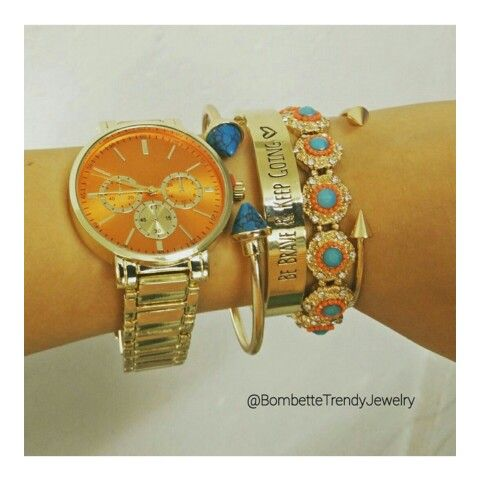 Orange and gold watch and conplements