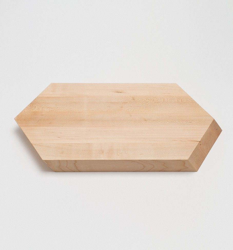 HEX CUTTING BOARD by Field is part of Wooden Home Accessories Cutting Boards - No  01 07 Origin Shipshewana, IN Designer Jonah Takagi Crafted in American Maple by Amish woodworkers in northern Indiana, the Hex Cutting Board's faceted design aids in handling and chopping duties   The Hex is available in two sizes, Large and Small   SPECS Dimensions Large IN 18 x 10 x 1 25 CM 46 x 25 x 3 Small IN 12 x 10 x 1 25 CM 30 x 25 x 3 Materials Solid American Maple treated with food safe butcher's block oil  Note