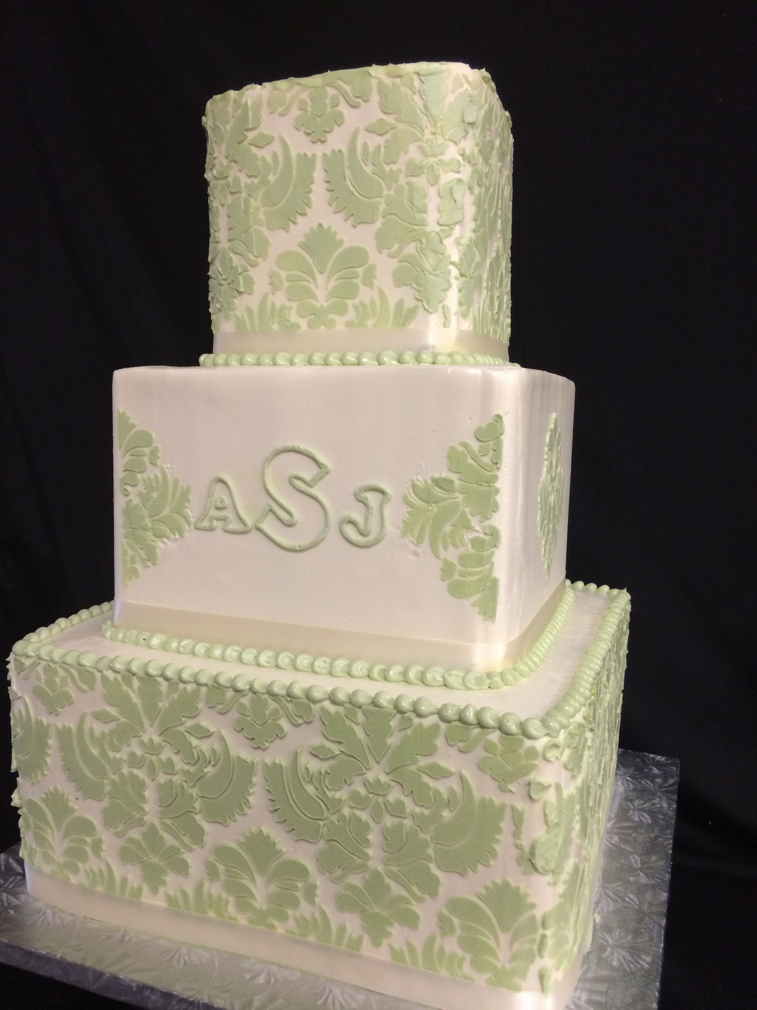 Pale green damask on this square wedding cake looks so fresh for