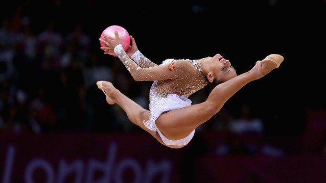 Evgeniya Kanaeva of Russia performs with the ball during the Rhythmic Gymnastics qualification on Day 13 of the London 2012 Olympics Games at Wembley Arena.