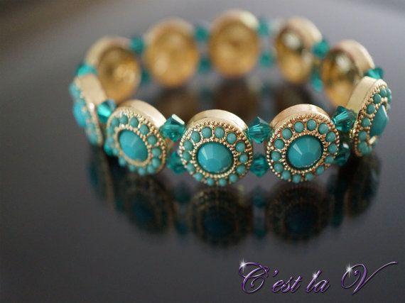 Cleopatra gold stretch bracelet.  Indian-inspired jewelry. Includes blue gems and Swarovski crystals $40    Website: http://cestlavjewelry.com/ Etsy Store: https://www.etsy.com/ca/shop/cestlavjewelry?ref=hdr_shop_menu