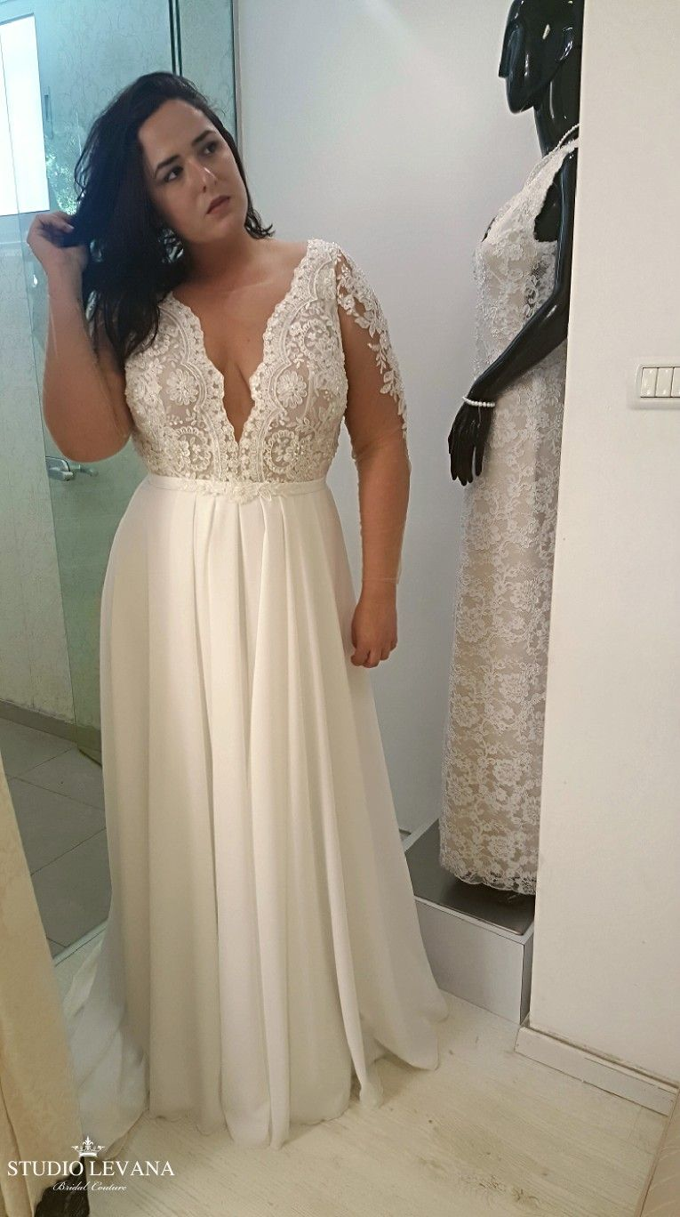 bdd318cc7c6 Plus size wedding gown with deep V and illusion sleeves. Petra. Studio  Levana