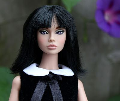 Portrait in Black Poppy Parker - Poppy Parker debuted in 2009 from Integrity Toys, the makers of the Fashion Royalty dolls, headed by fashion designer Jason Wu. Poppy's background story is that she is a teen model in the 1960s, and her wardrobe is a rich mix of vintage '60s fashion. - The Poppy Parker Resource: Dolls of 2009