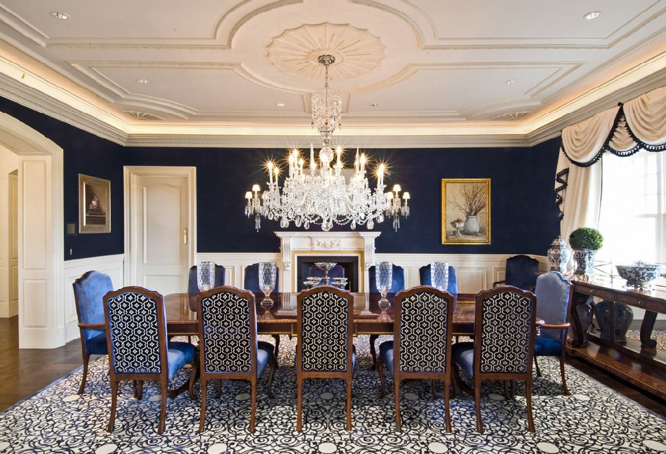 Stunning Blue Dining Room With Large Crystal Chandelier Fireplace