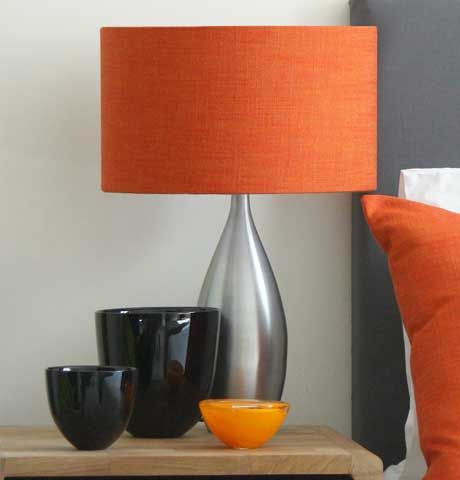 The Beautiful Clear Smoked Glass Lamp With A Drum Orange Fabric Lampshade Would Compliment A