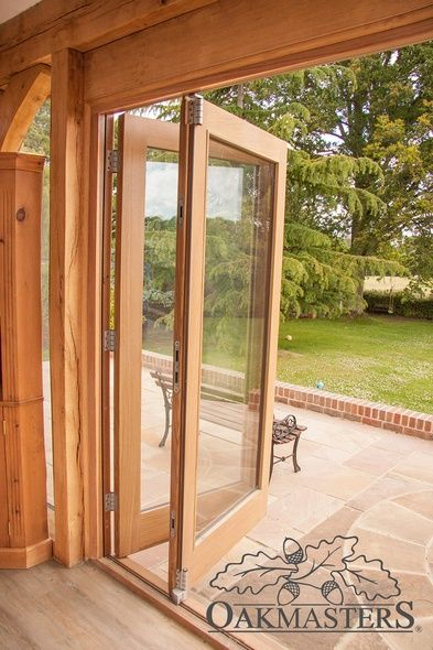 Oak framed extension with glazing and bifold doors - Oakmasters ...