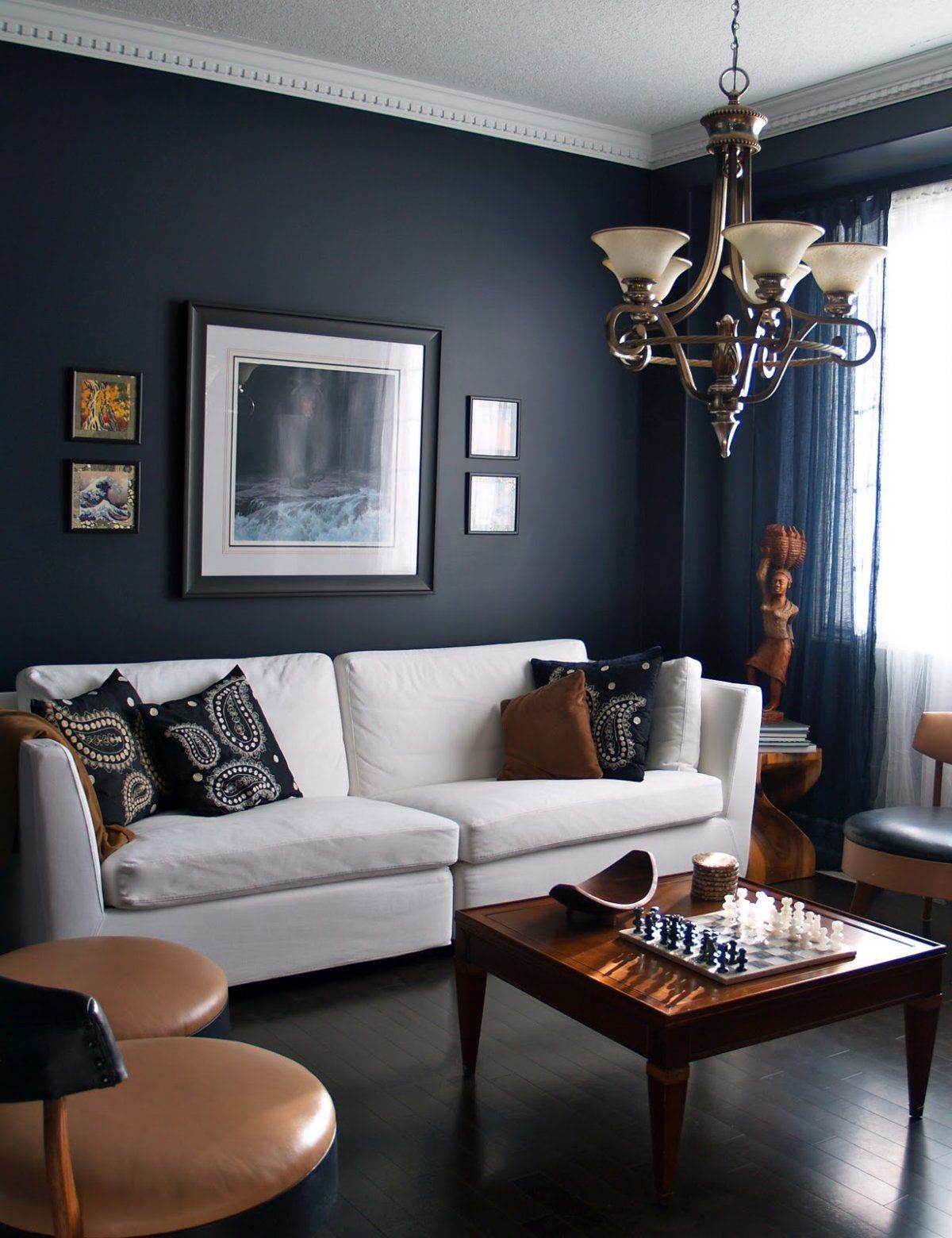 living rooms with dark navy blue walls with white sofa and classic