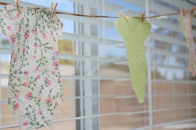 Baby Onesie on clothes line for decor...cute!!!!