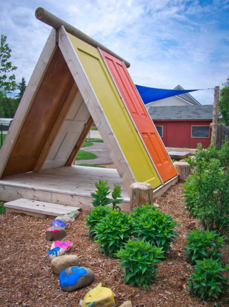 Mulch Or Playground Chips Make A Nice Play Area. This Is A Cool Backyard  Fort / Playhouse Made From Doors.