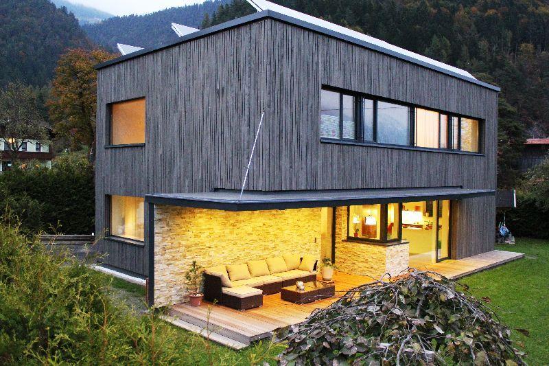 Tirolia Blockhaus Holzhaus Design als Würfel Haus