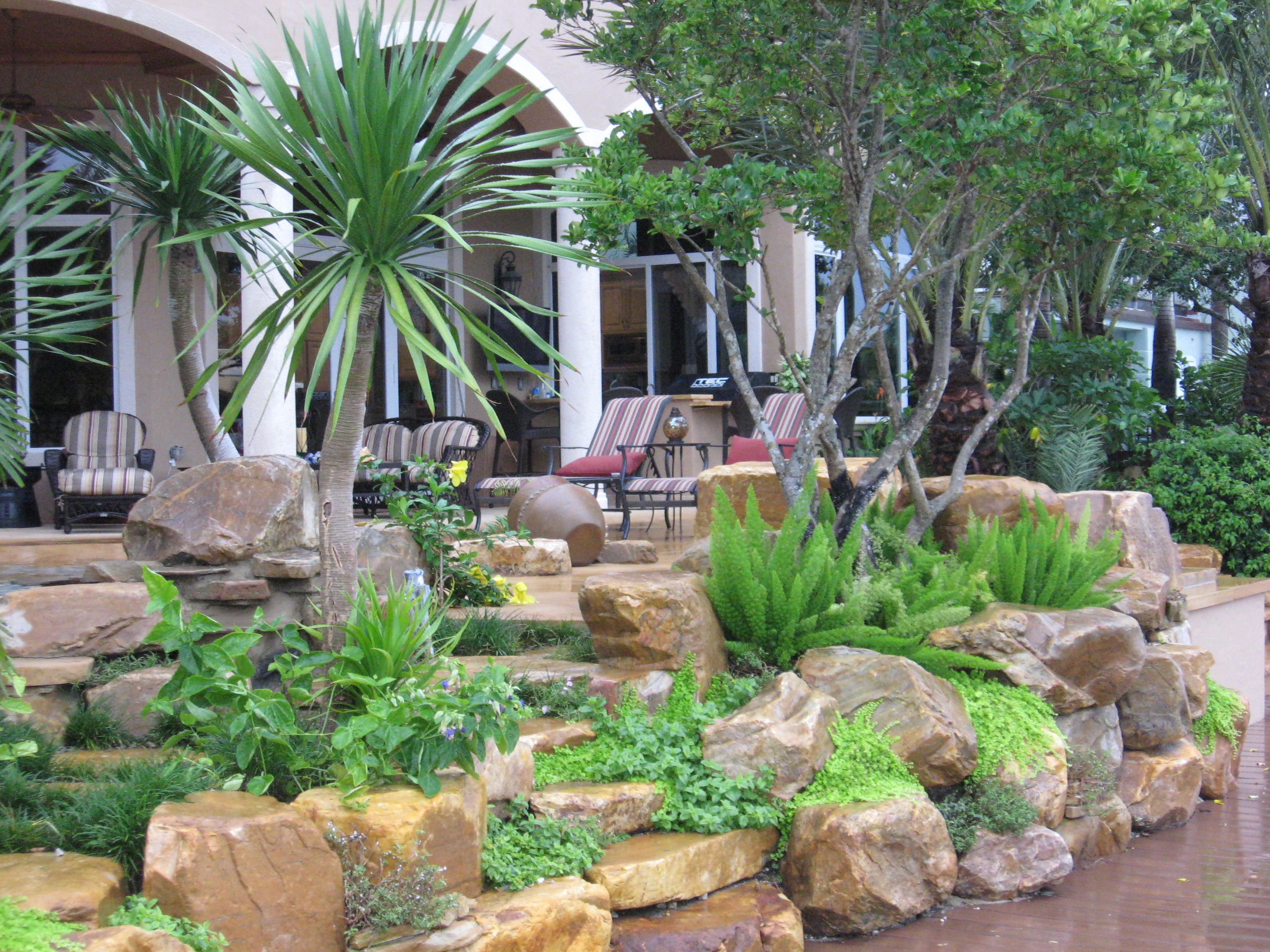rock garden wall by waterfalls fountains gardens inc tropical garden planting by ultimate