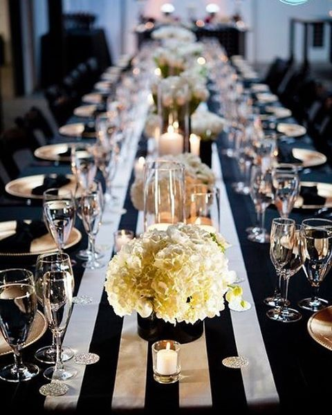 Black And White Striped Table Runner With Candles And Bowls Of Full