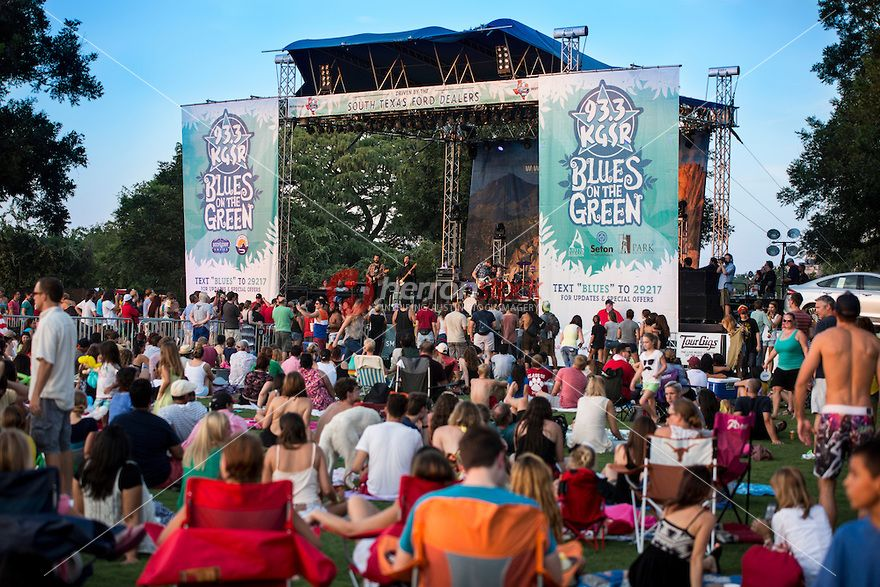 Blistering hot weather doesn't falter crowds from attending Zilker Park's Blues on the Green summer concert series in downtown Austin, Texas.