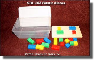 different size plastic blocks - cut holes in top of shoebox for sorting by shape