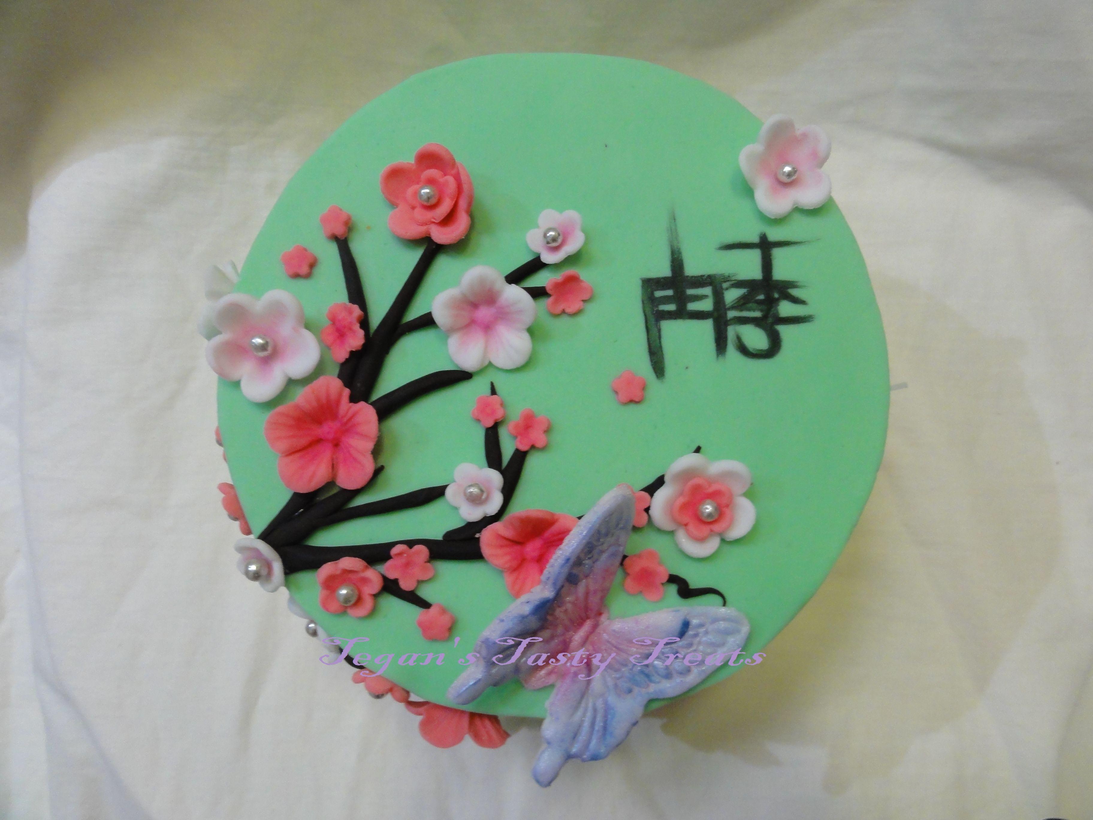 Top of the Japanese cherry blossom cake. Hand painted Kanji.