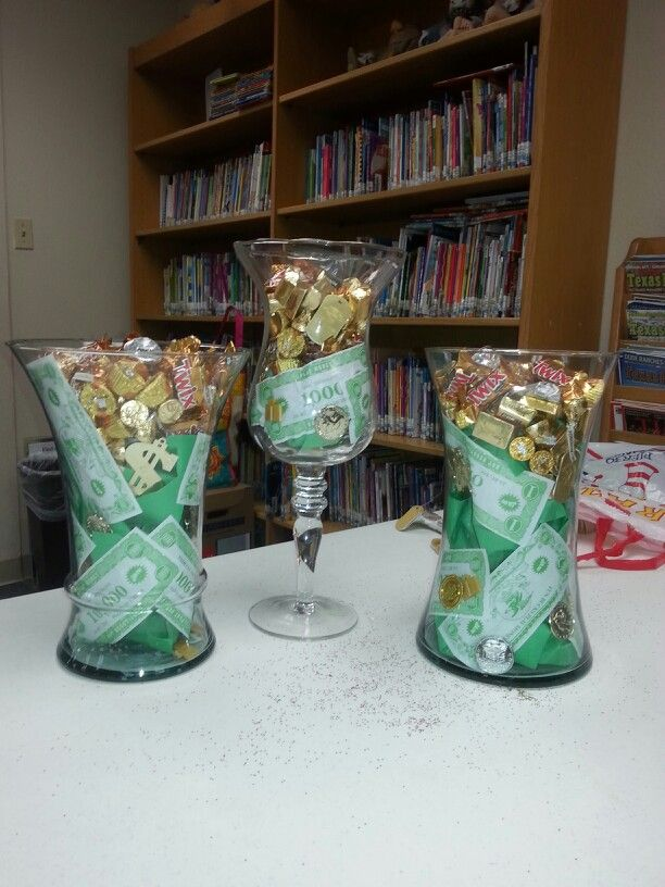 Centerpieces vases filled with money coins jewels