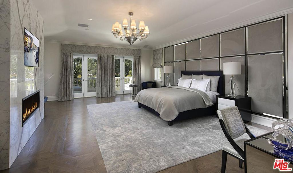 White Master Bedroom With Fireplace Tiled Back Wood Floors Area
