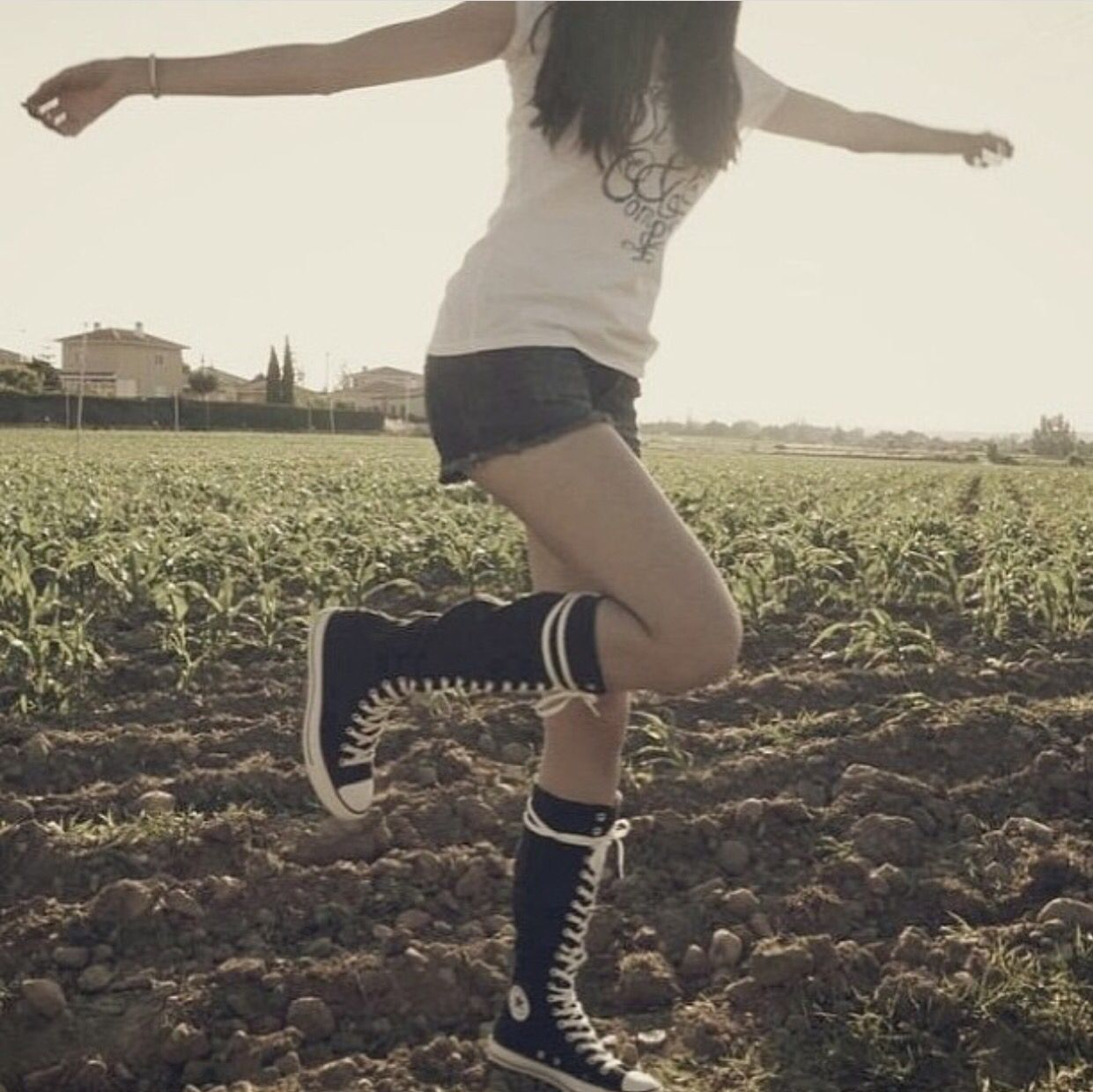 0ec22427d70 Me wearing my black knee high converse with shorts in the mid field I m on  a holiday to New Orleans and I ve only bright pairs of knee high converse  to wear ...