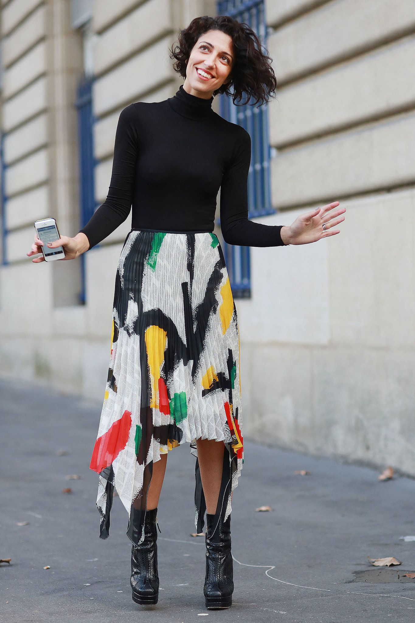 Yasmin Sewell tempered artsy pleats with a classic turtleneck.  Source: Tim Regas