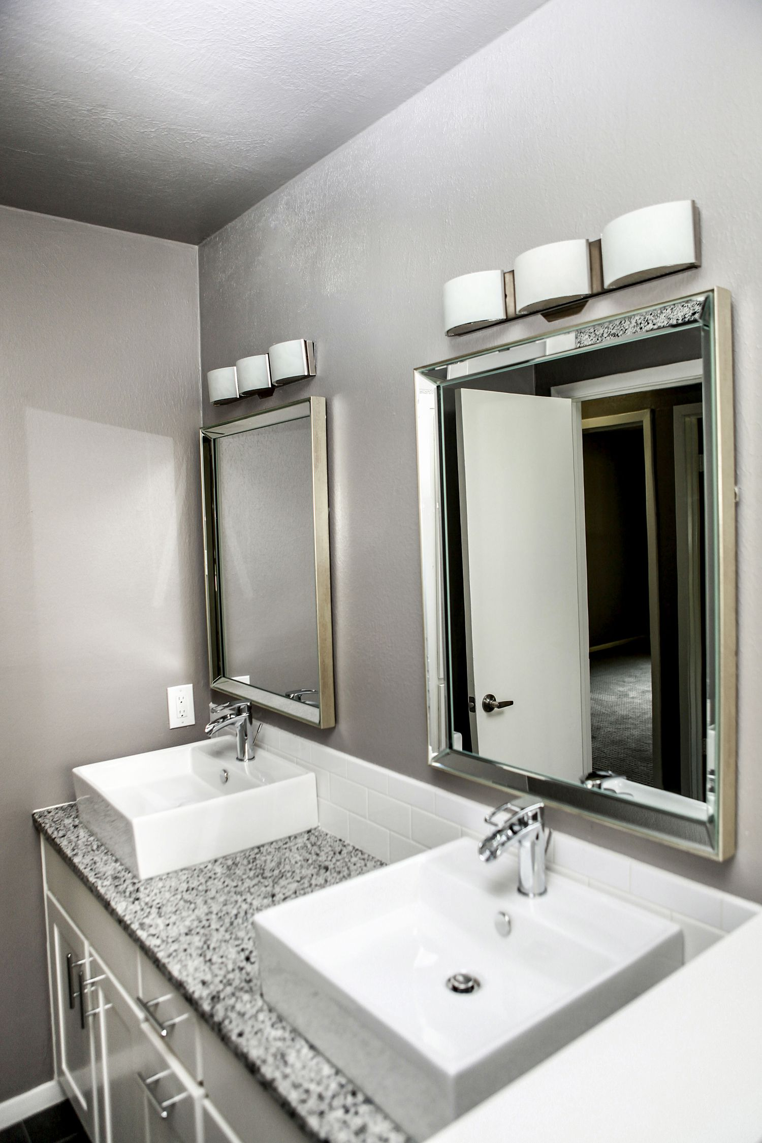 Double Sink Bathroom Vessel Sinks Gray Granite Counter Tops Walls White Custom Cabinets Remodel Modern Lighting