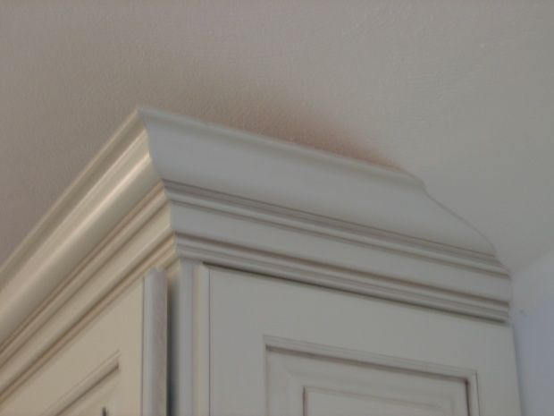 Vaulted Kitchen With Soffit Tapering Crown Molding On A Cabinet