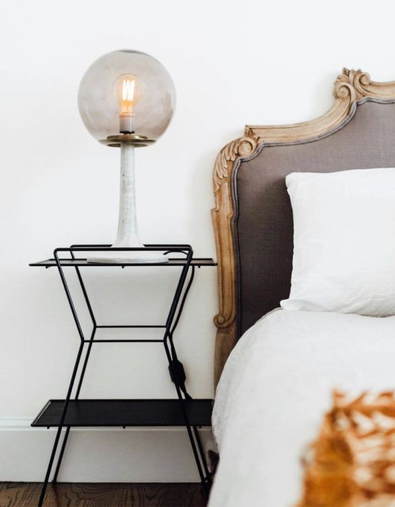 Black Metal Bedside Tables: Ornate Vintage Upholstered Headboard Paired With Modern