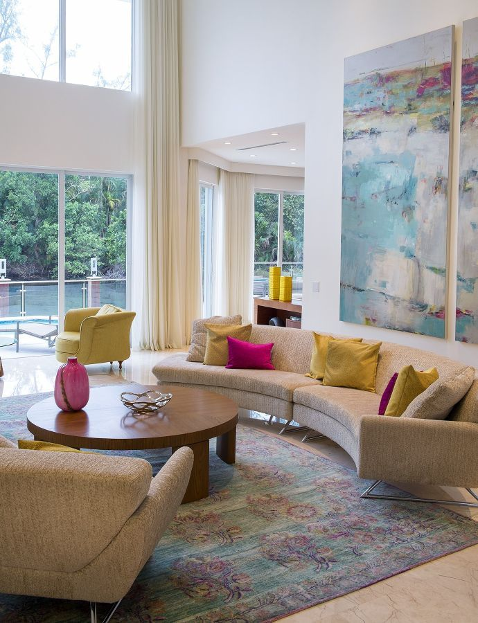 Pink and yellow accents lend a vibrant cheer to this ...
