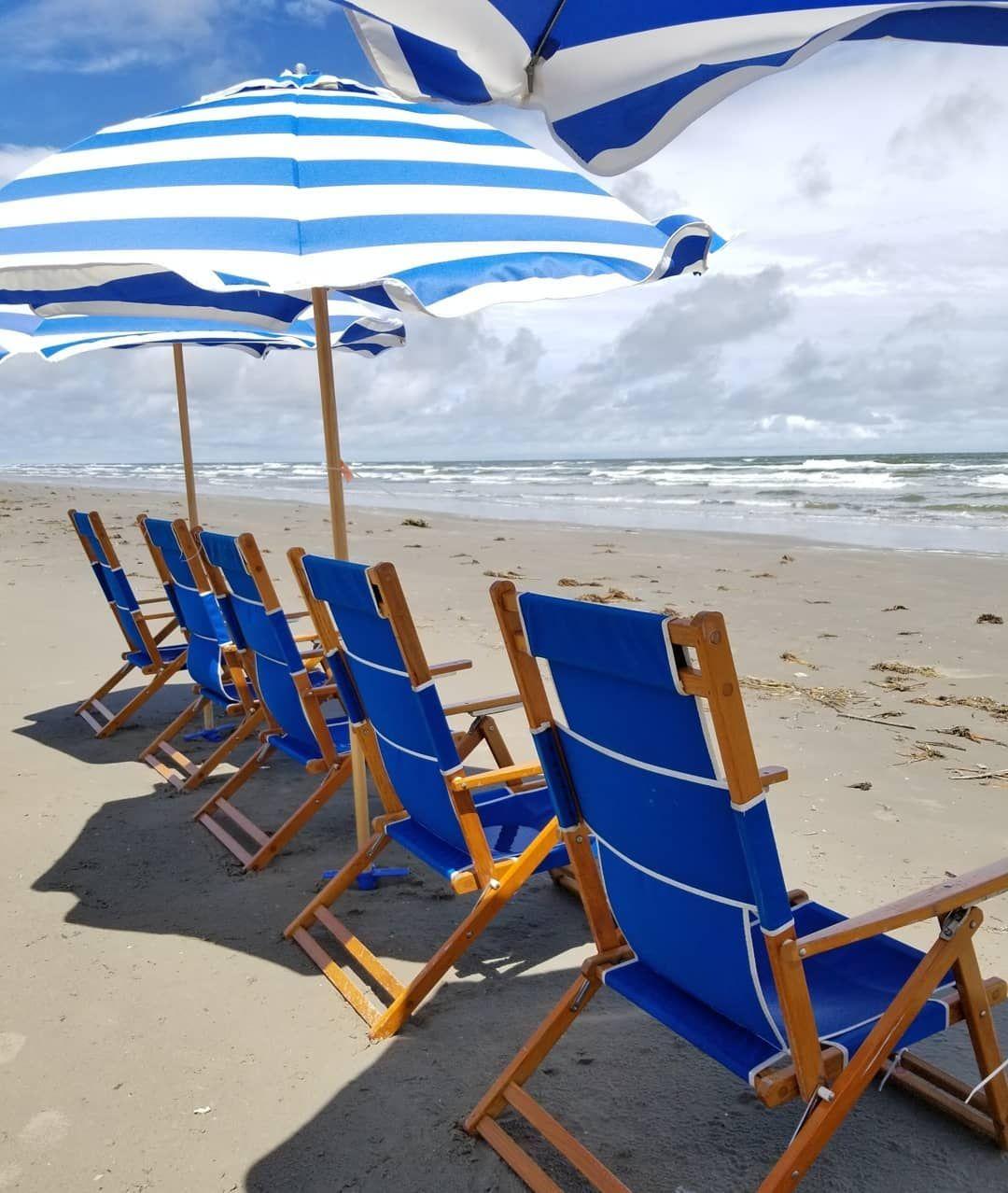 Beach chairs and umbrellas near Beachtown on Galveston