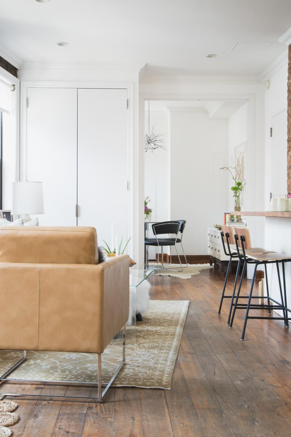 Unfinished wood floors give this New York City apartment