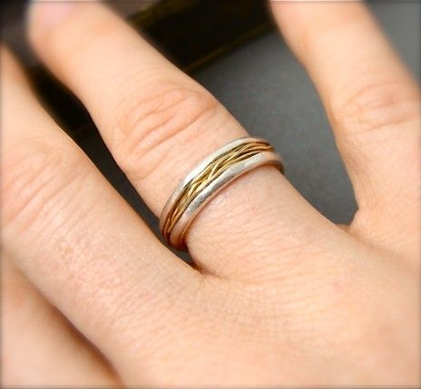 Overlapping layers of 24 gauge, solid 14k gold wire are stacked and intertwined around this delicate band ring. The straw like wire rests comfortably within the curves of the hand formed, fine silver. The edges of the silver has been delicately folded over for extra comfort. This organic and textural ring is about 1/4 wide.    Size: made to order *Please allow 1 - 2 weeks for domestic delivery. Let me know your size in the notes to seller section at checkout.    © copyright Siren Jewels…