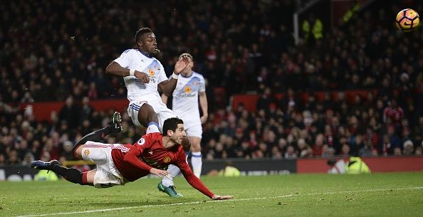 Manchester United's Armenian midfielder Henrikh Mkhitaryan strikes the ball with the heel of his boot to score their third goal during the English...