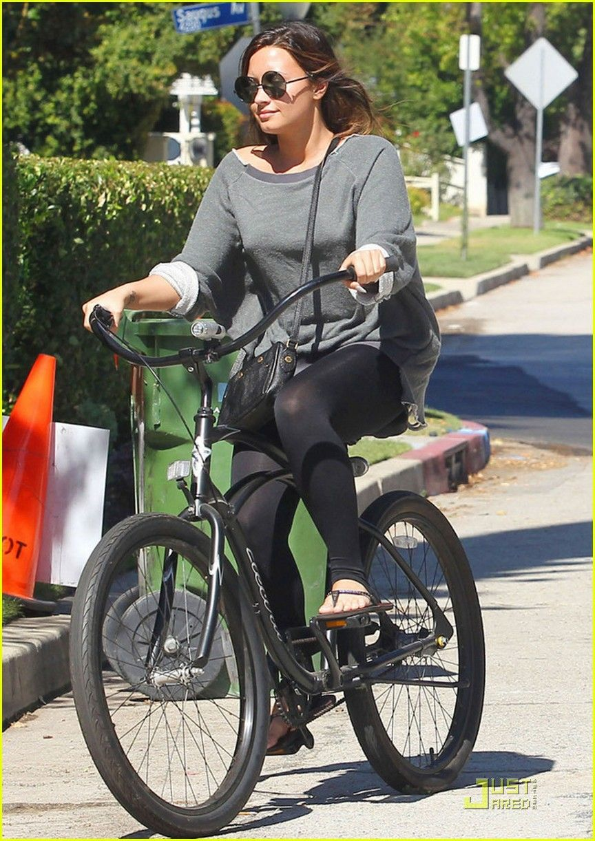 sunglasses for bike riding  Leonardo DiCaprio and Erin Heatherton go for romantic bike ride ...