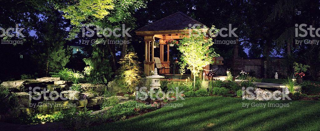 Garden at Night | Garden, Wooden gazebo, Backyard patio ...