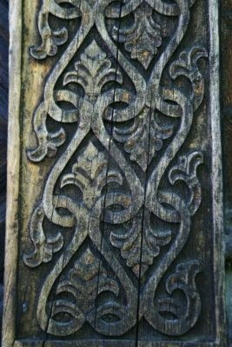 Carving detail on an old norwegian building photo by