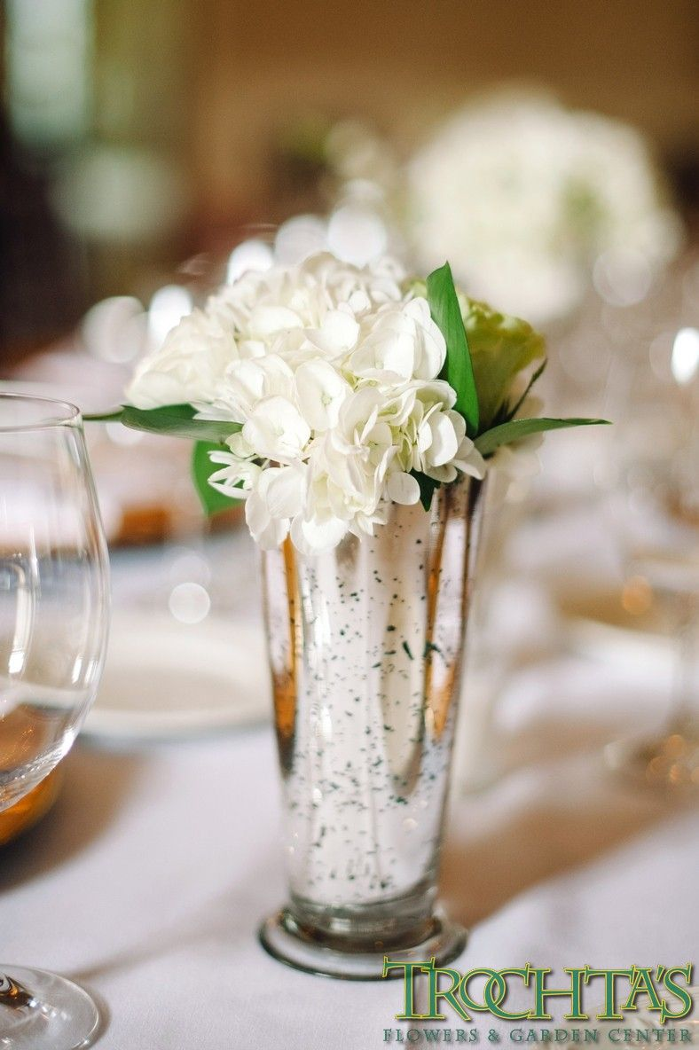 White hydrangea and ranunculus centerpiece. Photo by Candi Coffman ...