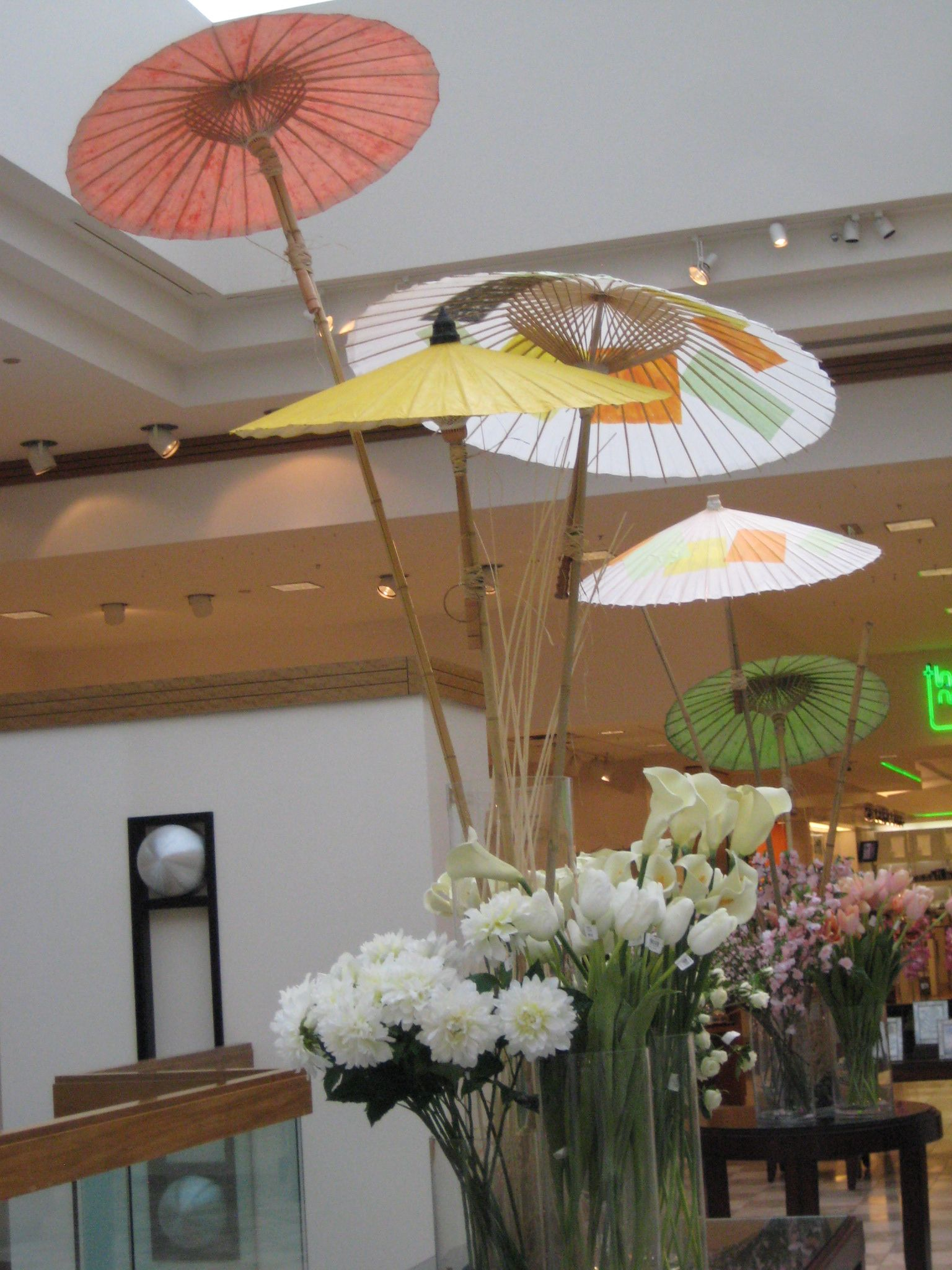 Fresh spring tones of paper umbrellas inserted into sticks