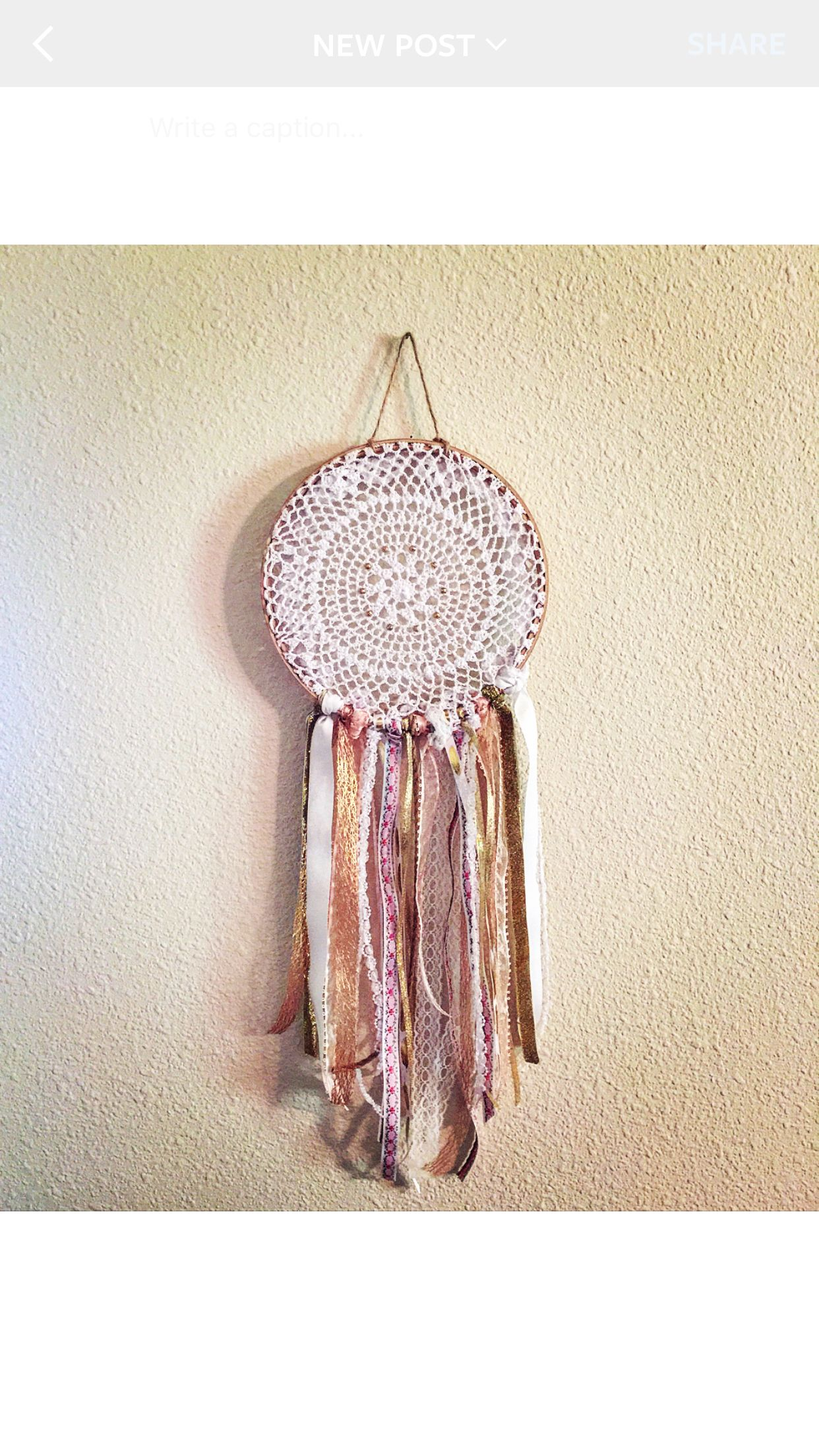 My homemade dreamcatcher. About $15 in supplies if you use the student discount at Jo Ann's. #diy #dreamcatcher #lace