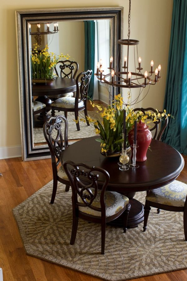dining room with a round table room for 4 chairs and a large