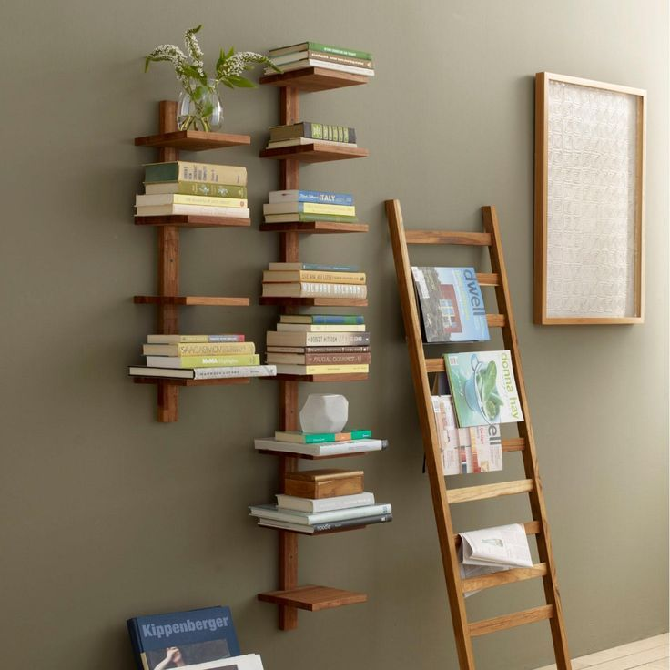 Talk about a conversation piece This vertical column teak shelf is perfect for  Talk about a conversation piece This vertical column teak shelf is perfect for