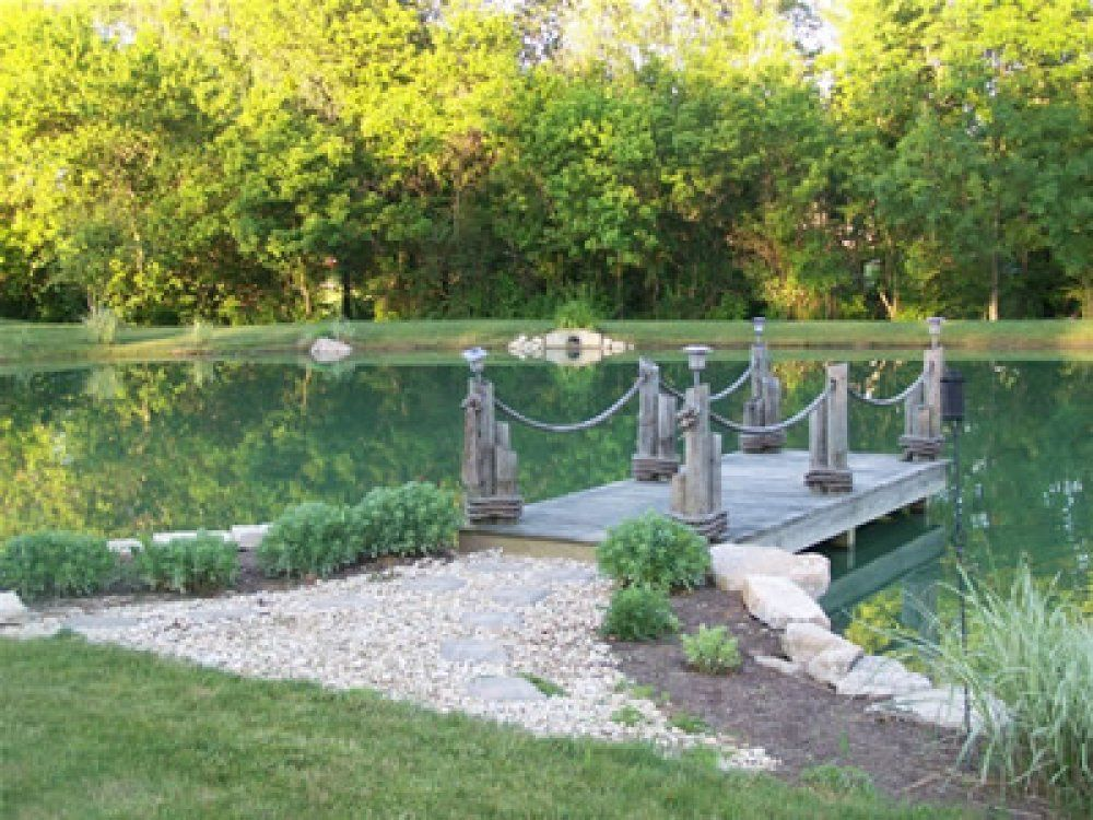 large ponds pictures | This outdoor pond has an arched ...