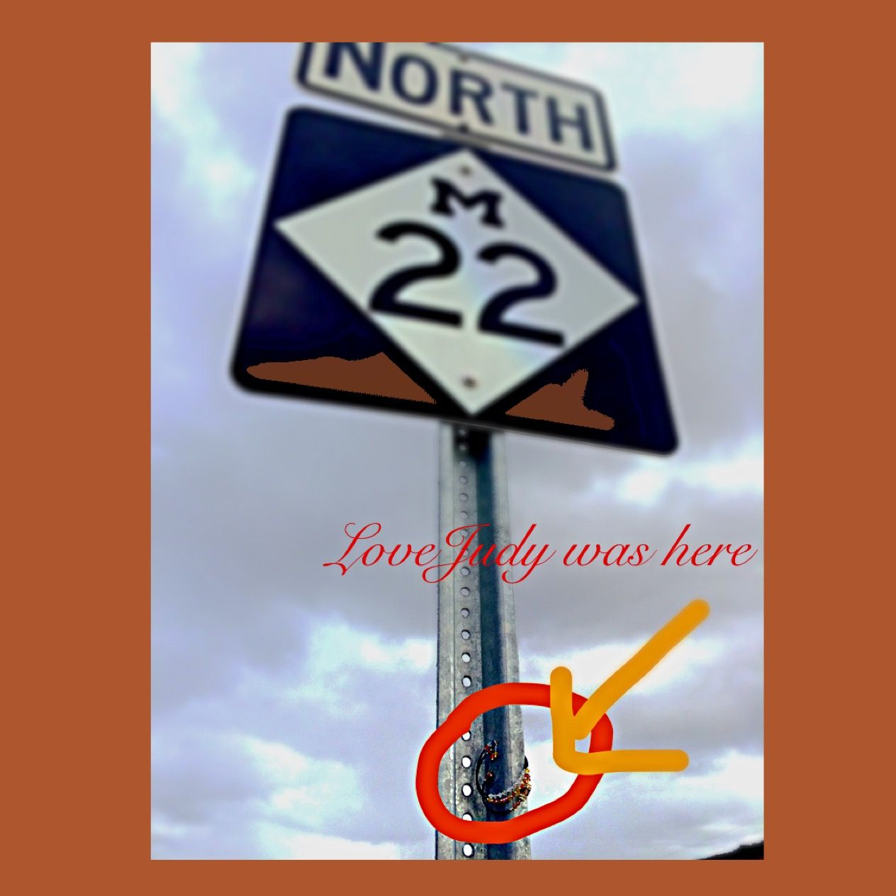 Love Judy Designs sighted on M22 sign near Traverse City, Michigan
