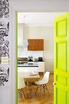 Splash of lime green in white and wood kitchen