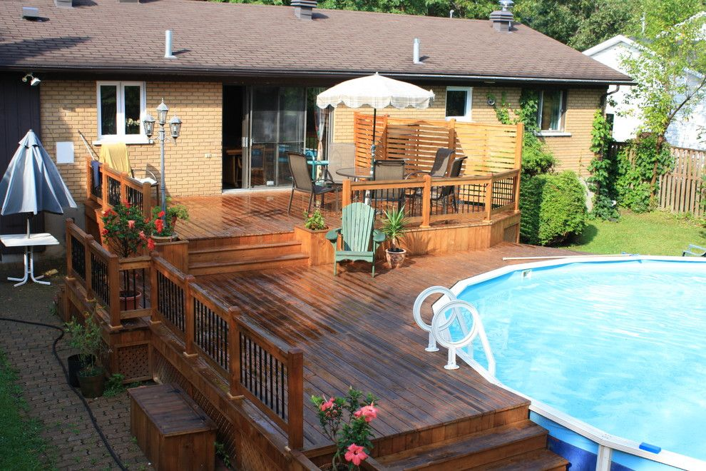 Above Ground Pool Decks Deck Traditional With Bois Traite Cedar Deck Jpg 990 660 Pool Patio Swimming Pool Decks Backyard Pool