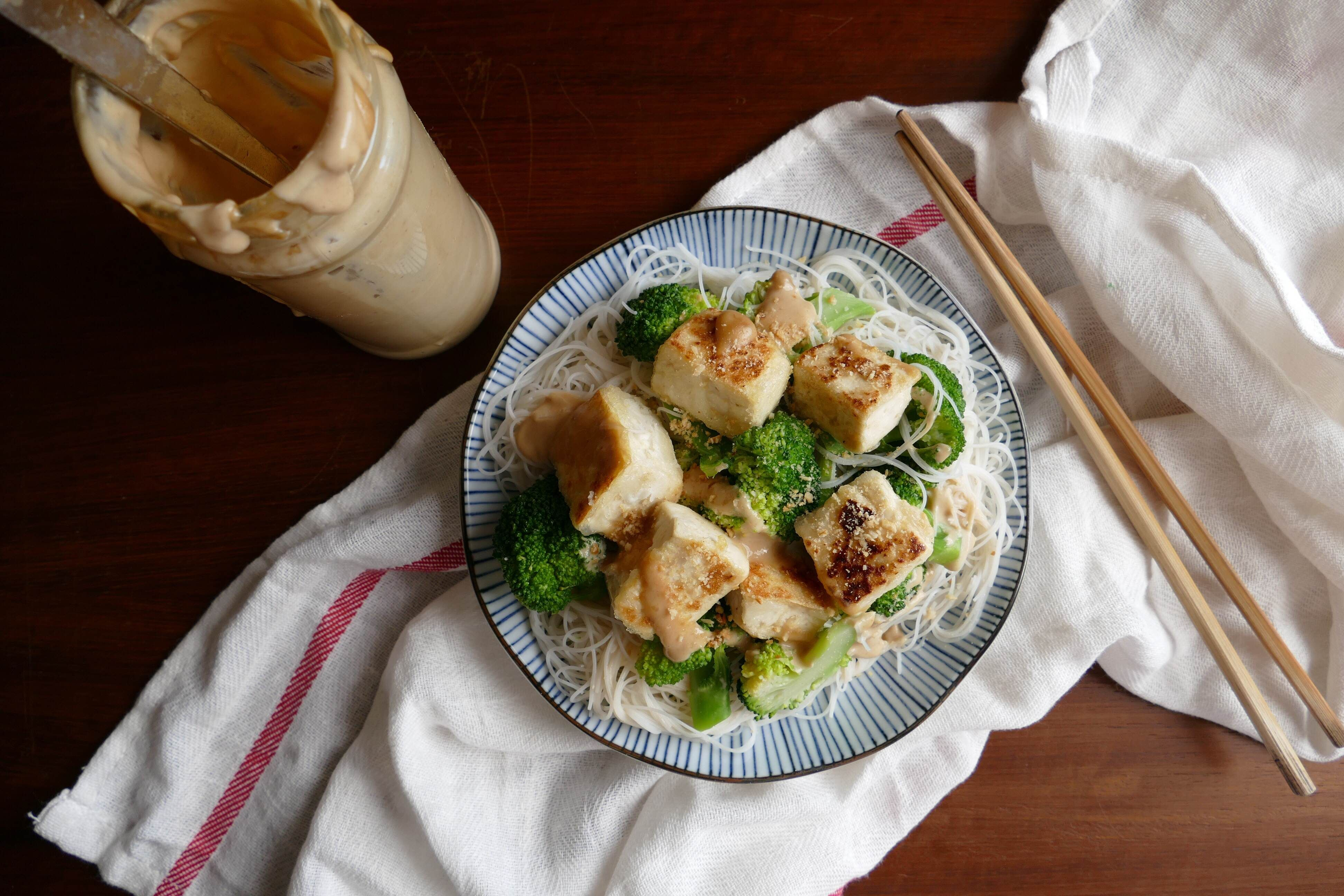 pan fried tofu with rice noodles and peanut sauce