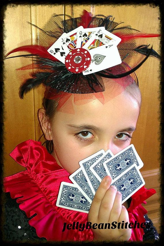 The Poker Face headband by: JellyBeanStitches. Wear a winning hand of poker right on top of your head. Mini playing cards with a genuine poker chip adorned with red and black feathers and tulle. Great headband!