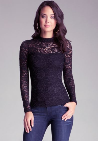 Stunning. A marvelous mock neck top with long sleeves, a printed design, and a half zippered back shoulder. Just add a riding pant and faux leather gloves.