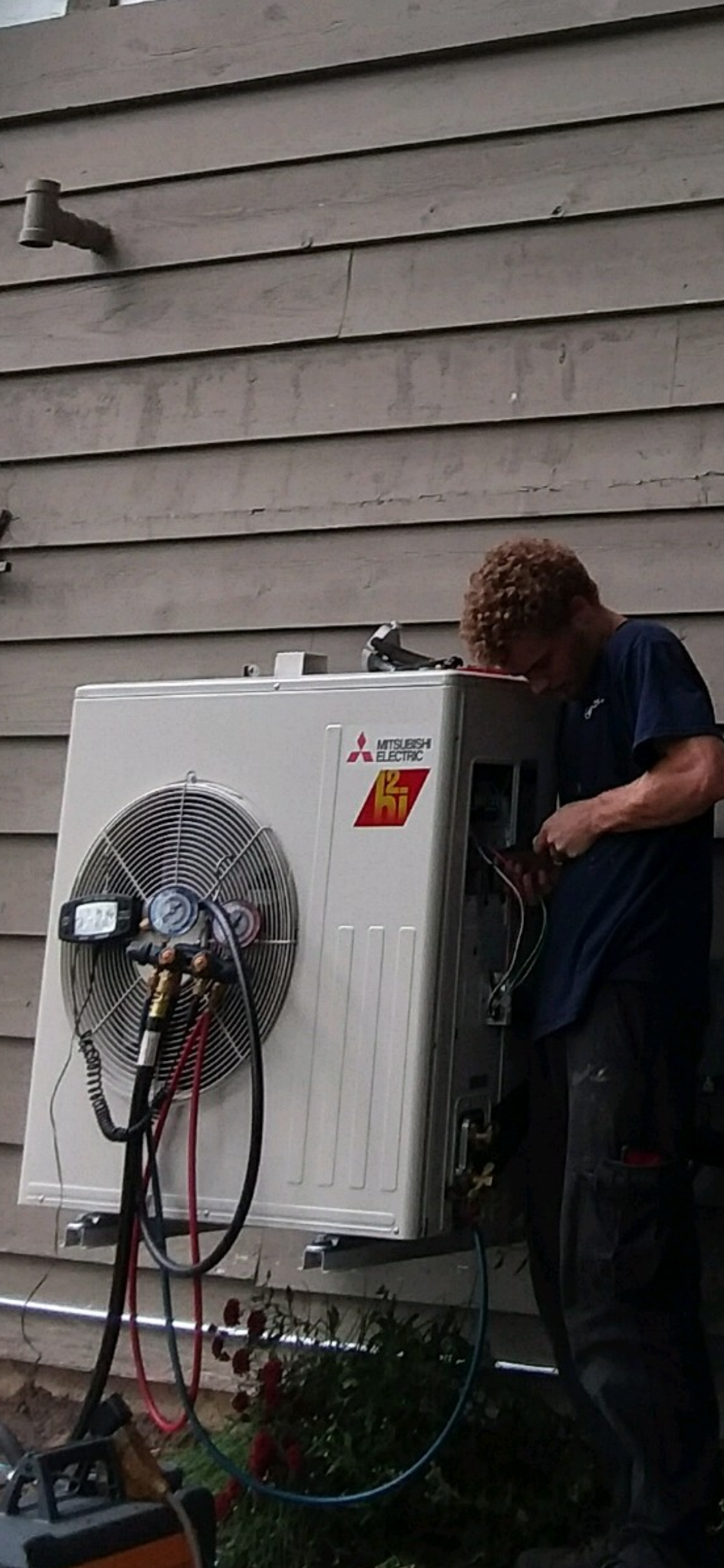 Compass Installation Technician, Kyle, installing a