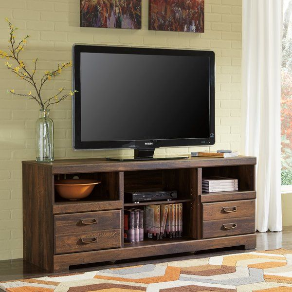 "Bathed in a rich, dark and wonderfully ""weathered"" finish, this TV ..."