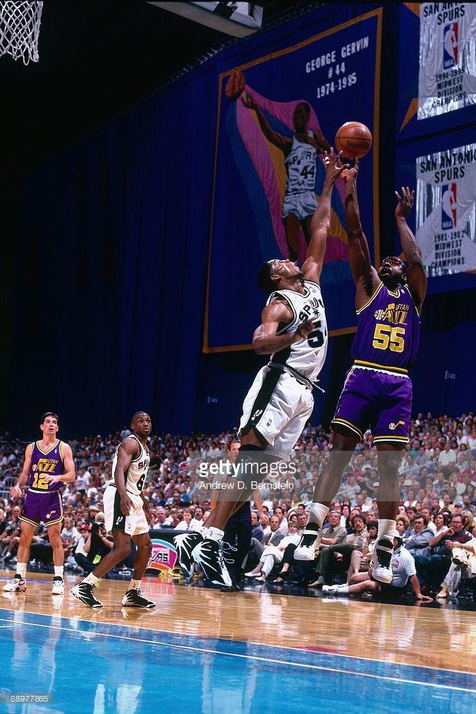 Antoine Carr of the Utah Jazz shoots a jump shot over Brad