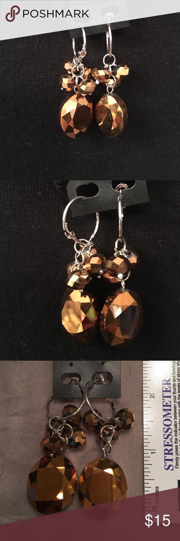 Gold tone Pierced Earrings Gold tone Pierced Earrings.   Deep rich tone of gold.  Very dress up dangle earrings.  Never been worn. Jewelry Earrings